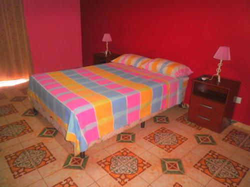 A bed or beds in a room at San Fernando Building