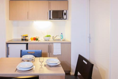 A kitchen or kitchenette at Aparthotel Adagio Access Saint Louis Bâle