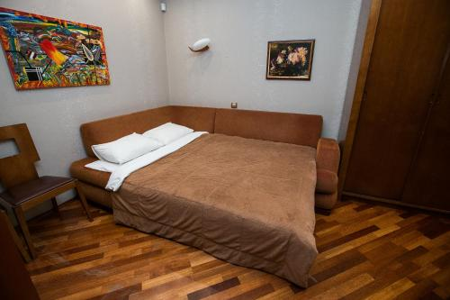 A bed or beds in a room at Apartments in Krylatskoye