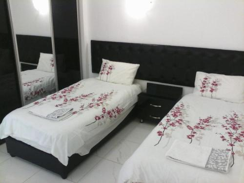 A bed or beds in a room at The Place Apartments