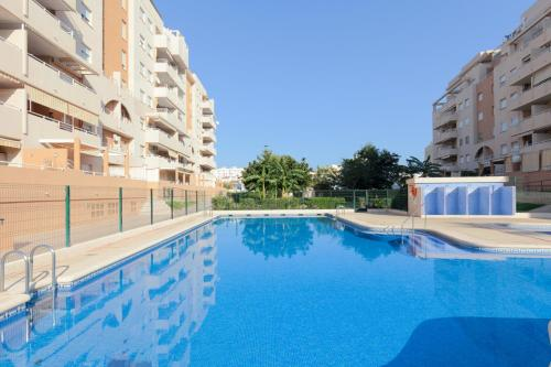 The swimming pool at or near Apartamento Jardines de Playa Gandia