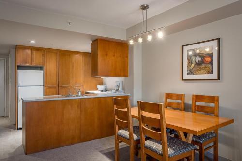 A kitchen or kitchenette at Whistler Peak Lodge