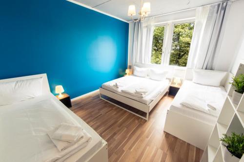 Un ou plusieurs lits dans un hébergement de l'établissement Hevals Grand Appartments Tempelhof