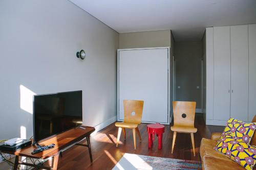 A television and/or entertainment center at Porto Insight Aparthments Cardosas