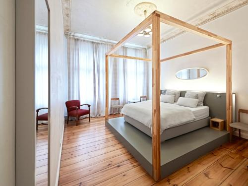 A bed or beds in a room at Linnen