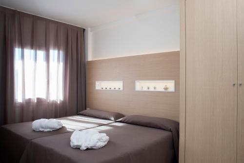Posteľ alebo postele v izbe v ubytovaní Aparthotel Acualandia