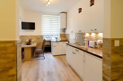 A kitchen or kitchenette at Flatprovider - Very Nice Apartment