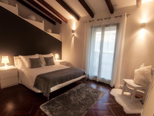 Ein Bett oder Betten in einem Zimmer der Unterkunft Apartamentos Igeldo