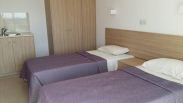 Postelja oz. postelje v sobi nastanitve Simos Magic Apartments 1