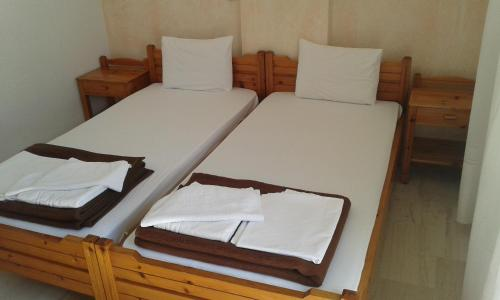 Letto o letti in una camera di Pension Kyriakos
