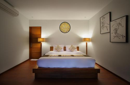 A bed or beds in a room at Bali Nyuh Gading Villas
