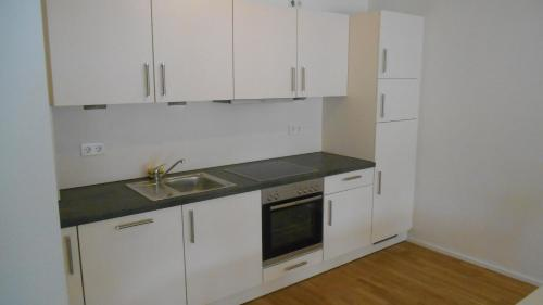 A kitchen or kitchenette at Stuttgart City Luxus Appartments