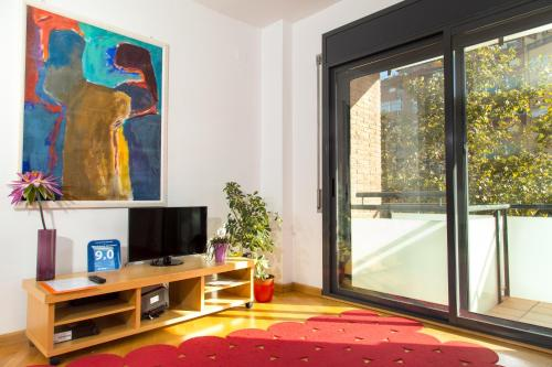 A television and/or entertainment center at New & Sunny Apartment