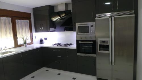 Una cocina o zona de cocina en Orange Tree´s House