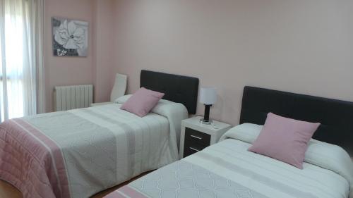 Cama o camas de una habitación en Orange Tree´s House
