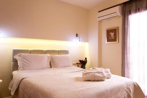 Un ou plusieurs lits dans un hébergement de l'établissement Leste Luxury Homes