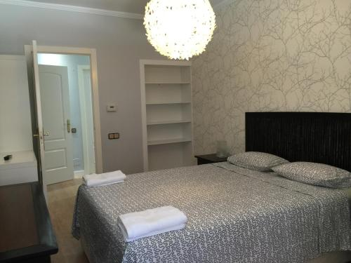 A bed or beds in a room at Apartamento Mauricio Legendre 16