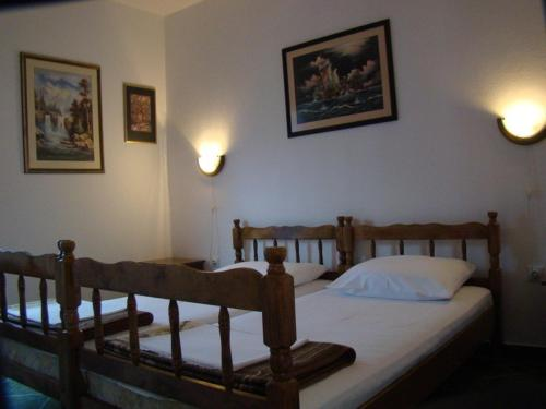 A bed or beds in a room at Apartments Svorcan