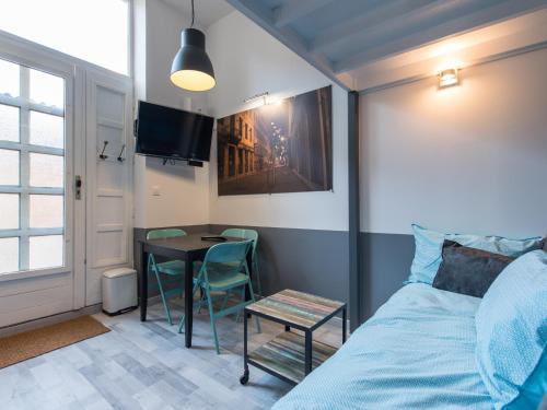 Ein Sitzbereich in der Unterkunft Appartement Ledin - Saint Etienne City Room