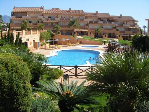 The swimming pool at or near Apartamento Alta Loma on Club La Costa