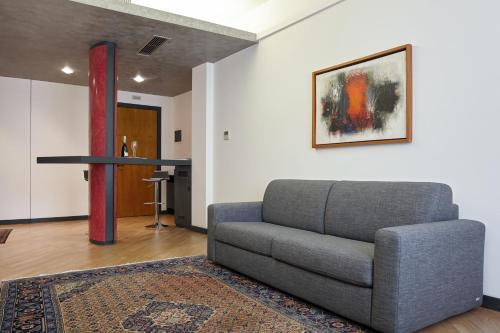 A seating area at Appartamento I Tenori