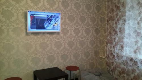 Телевизор и/или развлекательный центр в Apartment on Prosect Octyabrya