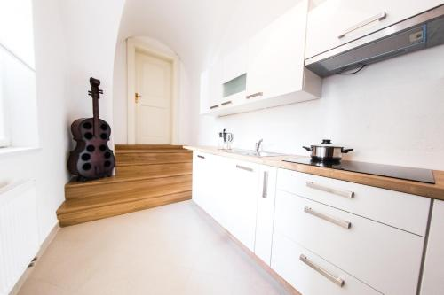 A kitchen or kitchenette at Three Golden Crowns Apartments