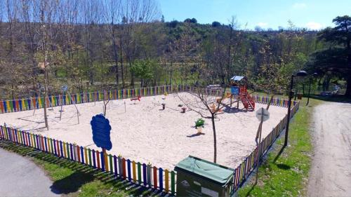 Children's play area at Parque de Campismo Municipal de Bragança
