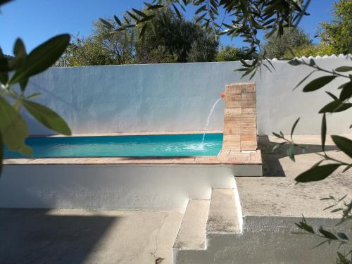 The swimming pool at or near Casa dos Grilos