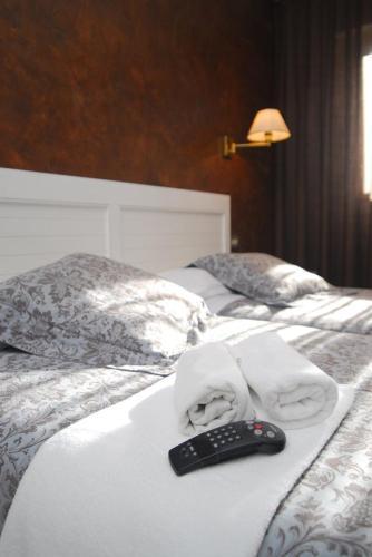 Cama o camas de una habitación en Hotel Iguareña