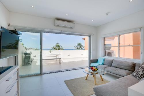 A seating area at Bondi Beachfront Penthouse Apartment