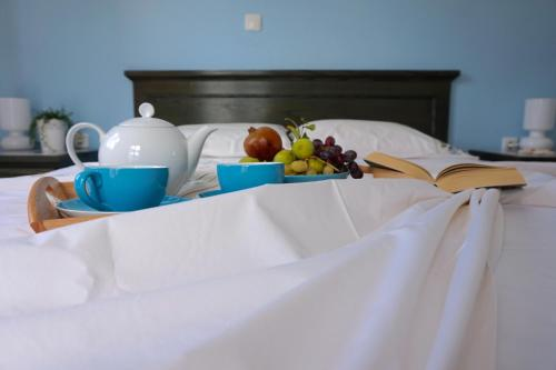 A bed or beds in a room at Cybele Apartments