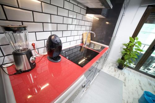 A kitchen or kitchenette at Apartments Madrid Las Letras