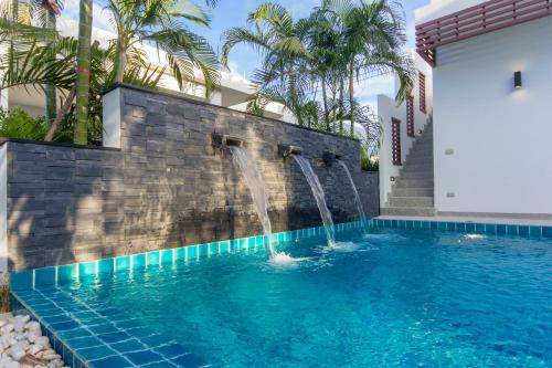 The swimming pool at or near Luxury House in Hua Hin