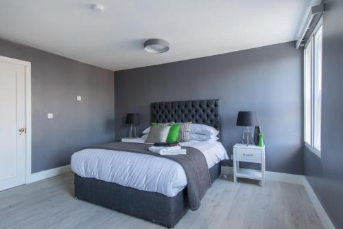 A bed or beds in a room at The Dawson Suite Apartments on St. Stephens Green