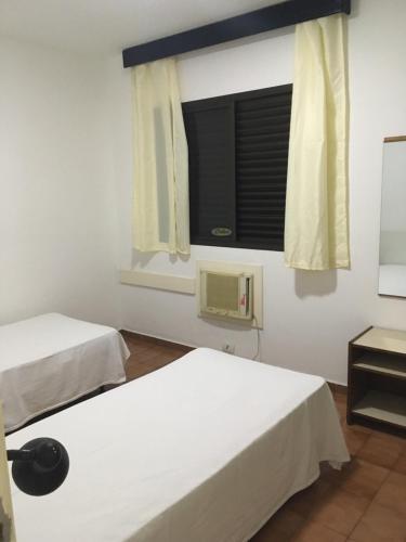 Apartamento no Guarujá - Flat Pitangueiras