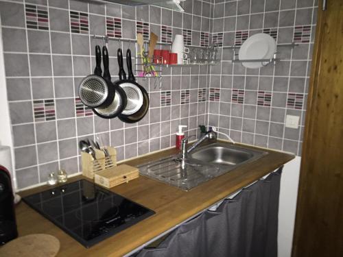 Cuisine ou kitchenette dans l'établissement Chez Nahiko