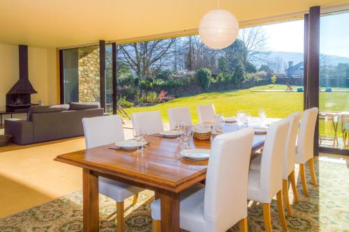 A restaurant or other place to eat at Liiiving In Caminha | Lawny Pool House