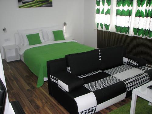 Postelja oz. postelje v sobi nastanitve Eva Luxury Rooms & Apartments