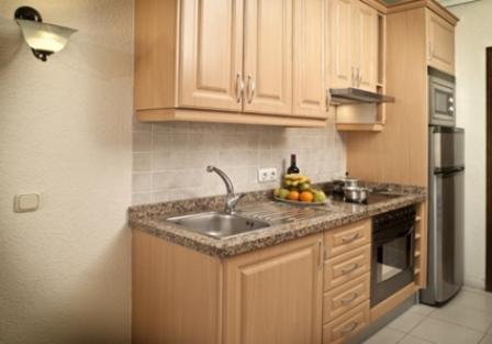 A kitchen or kitchenette at Paradise Court Aparthotel