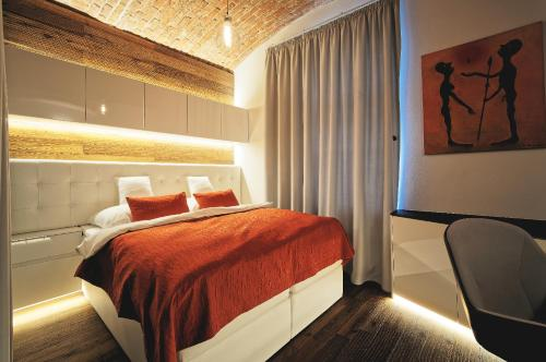A bed or beds in a room at Living Showroom Jakubská