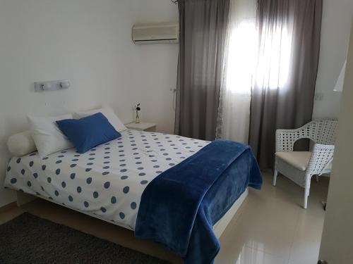 Ein Bett oder Betten in einem Zimmer der Unterkunft Oasis in the Desert