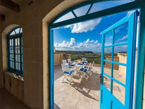 A balcony or terrace at Ta Rena Holiday Home