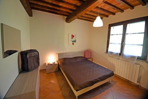 A bed or beds in a room at Poggio di Nocola