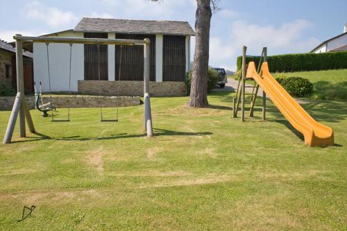 Children's play area at Apartamentos Rurales Casa el Abad