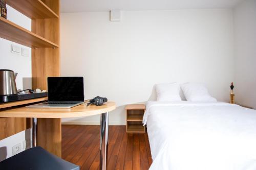 Een bed of bedden in een kamer bij Zola Park