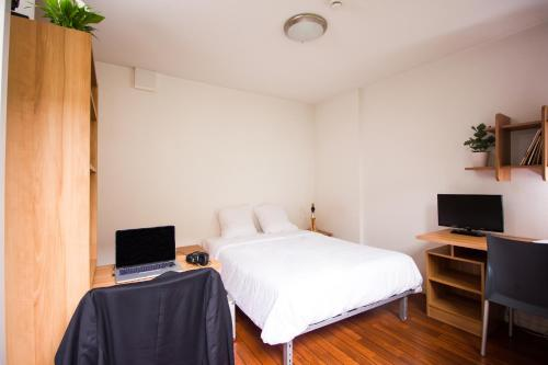 A bed or beds in a room at Zola Park