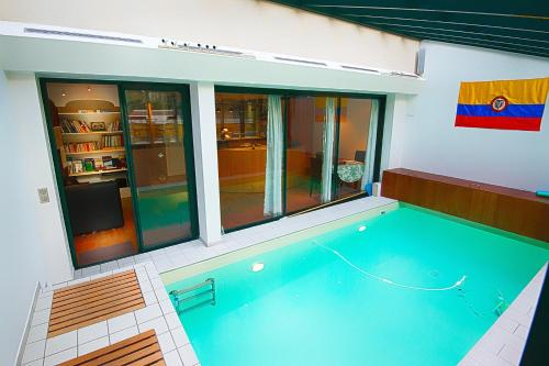 The swimming pool at or near Paris-Oasis