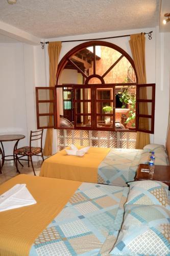 A seating area at Hotel Villa Florencia Centro Histórico