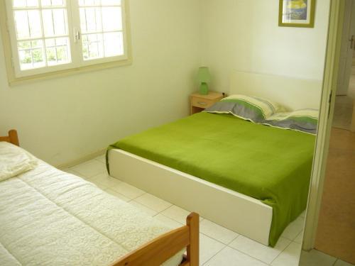 Un ou plusieurs lits dans un hébergement de l'établissement Villa Villeneuve Sur Lot